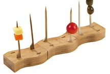 Skewer Holders and Displays / These unique displays enable beautiful hors d'oeuvres presentation, compatible with our great pick varieties. Served on our beautiful displays, colorful cubes of cheese, bright fresh fruit or small, hot finger foods have never looked more refined or delicious.