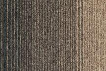 """Mocheta modulara Sky Valer Sintelon / Mocheta tip dale Sky Valer transforma orice podea intr-o opera de arta. Pentru un design extrem de interesant, artistii au folosit asa-numitele efecte de """"contagiune"""". Primul model din colectie, este o combinatie de negru si gri, un model foarte elegant, pretabil pentru birouri. Al doilea model este o selectie de nuante albastre si gri, ideal pentru spatii comerciale cu trafic intens. Ultimul, este format din bej, maro si negru, fiind recomandat restaurantelor si salilor de evenimente."""