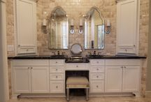 Lovely and Lavish / Lovely and Lavish - Marble tile with a black marble counter top, custom cabinetry, curbless shower, hidden drain, freestanding tub