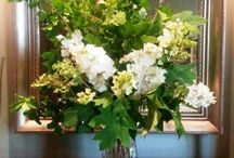Green and white flower arrangments