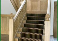 Grand Oak Staircase / Beautiful European oak, half-landing staircase has been customised by our client. We have manufactured 150mm square newels and 70mm turned spindles with a large section handrail. The newels have been finished with an artichoke-style cap.