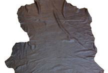 Genuine Lambskin Leather / Quality beautiful lambskin leather hides in black Charcoal color with a ¨cracked¨ rustic finish. This leather skin is soft and very easy to work with. The leather hide is light weight yet has a lot of body and would be great for any project.