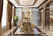 Дизайн загородного дома в стиле арт-деко в КП «Липки» / В доме много свободного пространства, и каждый гость чувствует себя комфортно. Столовая зона имеет отдельное помещение, которое соединяется с кухней. В уютной гостиной стоит диван и два кресла. Жители дома, отдыхая в гостиной, могут посмотреть телевизор и греться у камина. Дизайн-проект дома в КП «Липки» выполнен в стиле арт-деко.