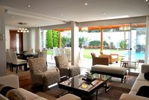 """Home Remodeling / The first floor of a home built in the 80s was remodeled to have a more contemporary look. The living and dining room furniture were designed to match the """"new"""" architecture style."""