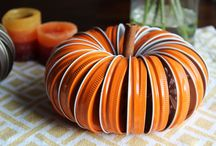 Rustic Thanksgiving Decor / Simple, easy and affordable DIY autumn craft ideas, including Mason Jar Lid Pumpkins made using our beautiful, rustic mason jar lids, twine and a cinnamon stick.