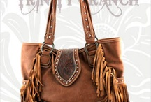 Trinity Ranch Collection / Trinity Ranch Collection combines the best of traditonal western elements with modern design. Our handbags and Jeans are in integral part of the modern cowgirl's outfit.