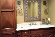 One-of-a-Kind Powder Room / This unique powder room design included a custom mirror designed and constructed by Lang's Kitchen & Bath using tile from the Moravian Tile Works.  The bathroom design was completed with reproduction industrial lights and a vanity unit with Florence panel doors, decorative legs and pull out racks.