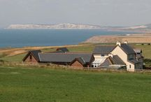 About Chale Bay Farm / Welcome to Chale Bay Farm -   a beautiful and individual award winning luxury guesthouse nestling among rolling fields with stunning sea views on the south-west of the Isle of Wight.  All our rooms are ensuite including full size bath with shower; complimentary beverage making facilities; HD satellite Smart TV; DAB/FM radio/alarm with MP3/iDock, telephone, room safe, mini bar; free WiFi.  Superior rooms have personal patios and panoramic sea views.