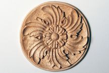 Hand-Carved Wood Rosettes / Rosettes are a type of appliqué. They are, by definition, artificial roses, which is why the most common motif is a flower; however, any circular ornament that radiates from a center can be defined as a rosette. Use rosettes as center pieces in ceilings and ribbed vaults, or as ornamentation on any furniture, cabinet, door, or wall panel.
