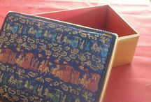 Covered Boxes / From one piece of cardboard cut to size a box is created when hand sewn with beautiful fabrics.  For special treasure of many sizes. The ring boxes are great at a wedding ceremony and  for keeping those0 treasures.