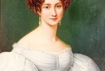 Ladies Hair - Fab 1830's top knots / The very best in Psyche Knots. Characterized by simple silhoutte around the face, hair swept into a single bun, knot or coronet of braids on the top of the head. Generally from center part.