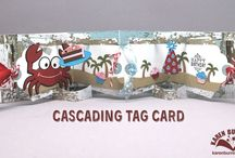 Cascading Tag Cards from Karen Burniston / Click here for a video tutorial by Karen Burniston on her Cascading Tag Card: http://bit.ly/28N9Le3. To create this mechanism, all you need are Karen's Adirondack Chair Pop Up and Tags Pivot Card. Next, decorate the card however you'd like!