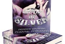 Sins of Silver /   A Biker Dark Romance.  A story of lawlessness and sin. Brutal and raw and completely unapologetic. Not suitable for people who don't enjoy violence, non-consensual sex, and harsh language.