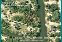 Great Price on Canalfront Outer Banks NC Lot for Sale | 2250 Tarpon Rd / Escape The Pavement & enjoy the privacy of this canalfront homesite. The lot sits on a cul-de-sac near the end of the canal system so there will be very little traffic coming by on land or water. Property may also qualify for a LOMA. There are not many areas in the country where you can buy beach properties like this at an affordable price, so buy this lot for sale now by calling me, Jean-Paul Peron, at 252-564-9390.