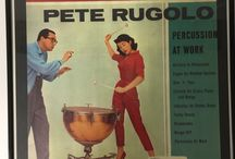 Fifties Albums with Pictures of Women and Percussion / I found it fascinating that there were so many albums with the women used as decoration for the album cover with the percussion instruments. These are my muses. My favorite is the one in red playing the timpani.
