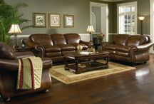 Brown leather sofa wall match