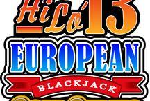 Hi Lo 13 European BlackJack Serie Gold / Su Voglia di Vincere, oltre a cercare di battere il banco facendo blackjack, con Hi Lo 13 Serie Gold il giocatore può piazzare un'interessante puntata esterna provando a indovinare se la somma delle prime due carte che riceverà sarà superiore (Hi), inferiore (Lo) o pari a 13. Azzeccando il 13, si è pagati 10:1.