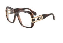 CAZAL VINTAGE 623 EYEGLASSES / With this style, CAZAL tried to create a sequel to a success story – and triumphed.  The 10-mm-strong material used in the predecessor as well as the intricate facet cuts required a stylistic update. Only in this way could the CAZAL 623 be accepted as a new style in its own right.  With the typical dominant temple hinge, a CAZAL hallmark in obligatory matte or shining gold, the relaunch was a perfect success. It was the beginning of a new success story – that of the 623. / by Vision Specialists Corp