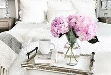Home sweet home / White and bright interior, retro or modern. A lot of wood and fluffy materials. And flowers .