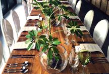 Fresh Fleur / Natural textures and shades form the basis of this event décor look. Large leaf tropical plants compliment green shaded glassware and wood textures.