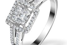 """Halo Engagement Rings / Our halo engagement rings are the ideal choice for brides-to-be who love opulent vintage styles with a modern twist of luxury. Each ring in our collections features a high grade, independently certified solitaire, with further accent diamonds forming a """"halo"""" around it. When the smaller diamonds in the halo reflect light, they increase the ring's overall sparkle and draw attention to the center diamond, creating the illusion of a much larger stone."""