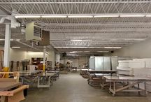 Industrial Painting by ASG Painting Serving New Haven and Fairfield CT Counties / Warehouses often have a dark and dingy interior with very little natural light. Painting everything white brightens the space giving it a more cheerful feel.