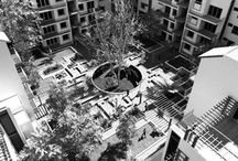 Courtyard Group Housing / Group housings with central courtyards encourage social characteristics and allow people to form communities. These central spaces are essential to overall functioning of the building complex.