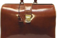 Men's Italian Leather Briefcases / A fine men's leather briefcase bag can make an impressive statement as you arrive at a business meeting. These bags may be all business, but they're definitely a pleasure to use.