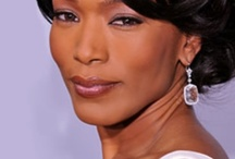 Dr. Esther Laurence / I imagine Angela Bassett playing Damon's grandmother, Dr. Esther Laurence. Super educated, super sexy!