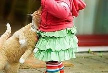 Children with animals . / I just love seeing Children and Animals together.