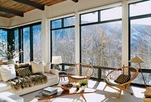 Ski condo ideas / living room with wood ceiling, white walls and windows trimmed in black