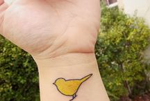 Yellow Birds / Photos, paintings, tattoos, decorative items and other artwork featuring yellow birds.