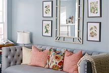 Grey walls blue sofa