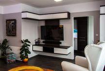 Realizace obývacího pokoje / Byt prošel kompletní rekonstrukcí. Interiér celého bytu jsme navrhli vmoderním stylu se zakomponováním původních prvků, které chtěl majitel zachovat.