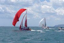RoundSardiniaRace / La circumnavigazione a vela della Sardegna con il mini Illumia di Michele Zambelli. Le immagini