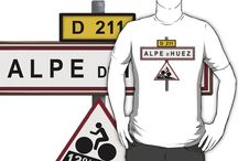 Alpe d'Huez Cycling T Shirts / Cycling t shirts for fans of the Tour de France. Alpe d'Huez is one of the toughest climbs in the world, making for epic battles each year in the Tour de France. Cyclists come from all over the world to ride the climb.