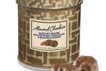 Crazy for Chockies / Packaged in a gold luxurious keepsake tin - Chockies are hazelnut praline, rough rounds that are rolled in milk chocolate and contain a different filling. Created to be enjoyed and the tin to be treasured.