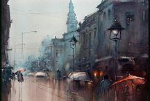 città sotto pioggia riflessi rossastri faro macchine