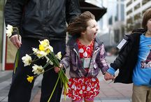 Daffodil Day / Pike Place Market celebrates the first day of spring each year by passing out more than 10,000 daffodils grown by Market flower farmers to downtown Seattle residents, workers and visitors