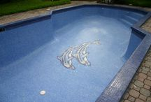 Designs of Foreverpools / #Foreverpools - Various #decorative patterns and #mosaics can be formed on the pool's floor and walls using #glass #tiles, from whimsical #murals of sea creatures to #colorful sunbursts in yellow and orange glass to more #sophisticated patterns #like these custom made #designs including #hotel #logos, #glowing #butterflies or #colorful #flowers.