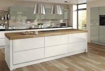 Kitchen Inspirations : Wood & Gloss / I love modern contemporary kitchens with a rustic twist. Gloss and wood, gloss and wood effect laminates, wood veneer and laminate worktops and splashbacks mixed with gloss or matt doors.  The mix of new and rustic, contemporary and classic works very well. I showcase my own kitchen too.