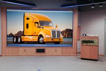 "dnp Giant Wide Angle Screen / dnp's Giant Wide Angle Screen is the world's first 200"" optical rear projection screen. With an image area of up to 3 x 4 metres, it offers the size of a 5 x 5 cube videowall in a one-piece screen. Due to its optical lens design, the dnp Giant Wide Angle Screen offers exceptional brightness and contrast levels, making it an impressive medium for high-quality projection of large images in conference rooms, lecture halls and control rooms with long viewing distances."