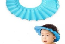 waterproof baby shower cap / by icart sg