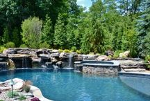 Natural Rustic Swimming Pool and Spa Design / New swimming pool and spa design in Midland Park NJ, nestled into the corner of the property. Boulders, water features and expansive patio space.