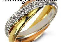 Кольцо Cartie Trinity из комбинированного золота / Золотое кольцо Trinity Cartier Картье Тринити http://bgs.kiev.ua/cartier-14kz Best Gold Service Ювелирное предприятие – изготавливает на заказ обручальные кольца любой сложности.  Обручальные кольца Trinity de Cartier Из трех цветов золота (белое, желтое, красное) Изготавливаем золотые кольца любой пробы и цвета, с любыми вставками (бриллиант, циркон, кристаллы Swarovski и т.д.).  Тел.: +38 (095) 311-55-74  Тел.: +38 (063) 274-75-55 E-mail: bgs.kiev@i.ua  Сайт: www.bgs.kiev.ua