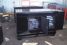 MANUFACTURERS OF NEW INDUSTRIAL GENERATORS BY KRAUSEGEN GENERATORS / Krausegen specialize in servicing , maintenance and manufacturing of generators. Our products range stretches from 15 KVA – 3000 KVA and includes : Perkins, Volvo, John Deere, Lovol, Scania, Sdec and F.A.W.  We also specialicing in Generator Supplies, Generator Installations, Generator Canopies, Generator Panels and Mobile Generators.