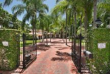 """PONCE/DAVIS REAL ESTATE - 4850 SW 80 Street / The enchanting Villa Las Palmas is a breathtaking, French Inspired sanctuary in the heart of """"The Platinum Triangle"""" in Ponce Davis. This private and gated property includes a formal living room with a fireplace, dining room, Florida room, and a gourmet eat-in kitchen. A luxurious master suite offers a sitting room, spa-like master bath, and private balcony with views of the pool, patio, and gazebo."""