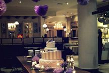 Real Wedding : Purple & Green  / We decorate Pastis Cafe with lights, purple flowers and paper pom-poms. Copying the venue's vintage look, we used white furnitures & crystal chandeliers. We bring the outdoors in by putting lots of greens too