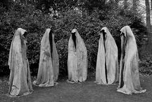 hooded figures