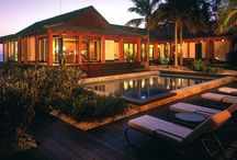 Seijaku by ZEN Associates / This contemporary Asian retreat encompasses a main residence, a two story guest house, and a Japanese Garden. Inspired by Japanese style, the architecture reflects a striking minimalist design, while native landscaping turned the one-acre site, bordered by the Gulf of Mexico on one side and the Intracoastal Waterway on the other, into a Zen-like jewel.